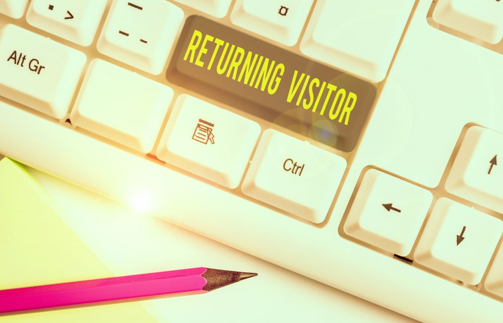 keyboard with the enter key showing returning visitors